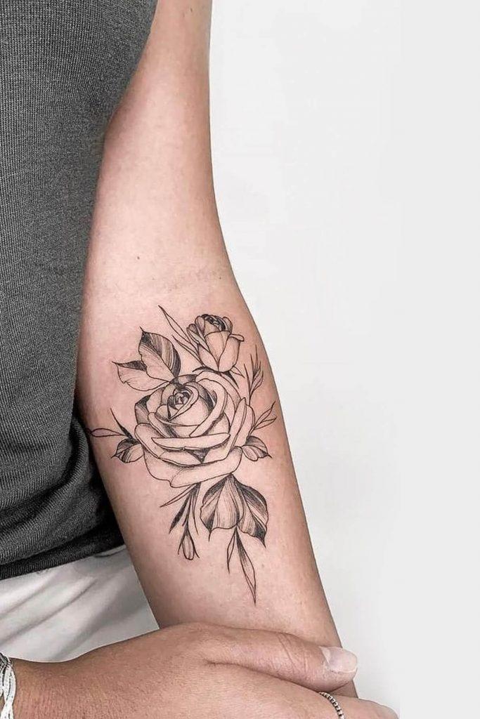 Kadın kol geçici çiçek dövmesi modeli